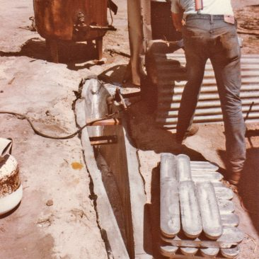 Pouring the lead keel into the ferro cement mold that had been cured in the ground for several months (to accommodate the 13,500 pounds of molten hot lead)