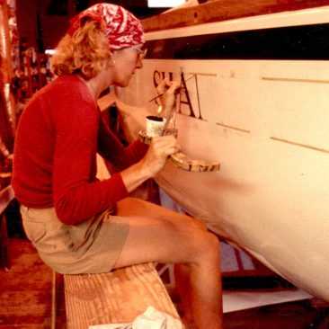Toni Shea of Mad Duck Signs paints on Shanachie's name for the first time