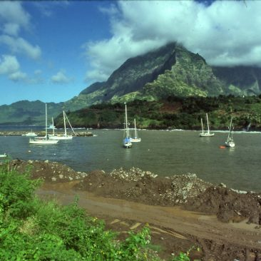 Arrival in the Marquesas at Atuona, Hiva Oa...Shanachie is far left, front. When we returned 22 years later, we found a busy, thriving harbor with over 30 boats anchored here, and the mud road was very much paved. Paul Gauguin and Jacques Brel are buried about 30 meters apart in the cemetery on the hill in the background.