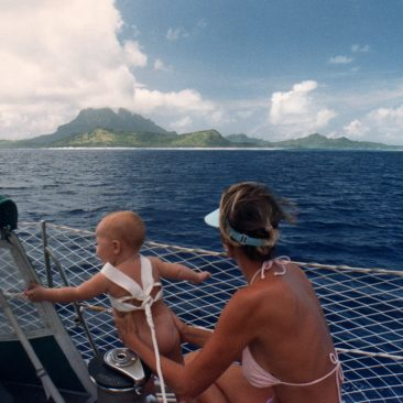 Baby on board... our future Admiral (Kali at 9 months old) properly wearing her safety harness (and nothing else) as we approach the island of Bora Bora.
