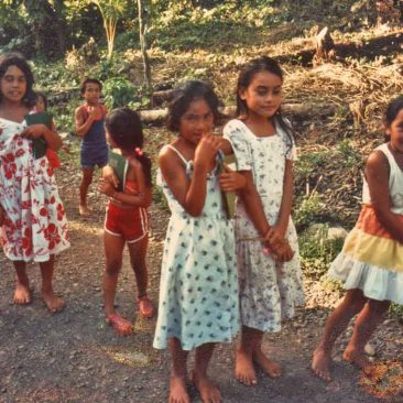 Shy girls of Hanaiapa, Hiva Oa. Little did any of us know then that the young girl to the right of center, daughter of Anna and Teiki Moke, was to become a future Miss Tahiti.