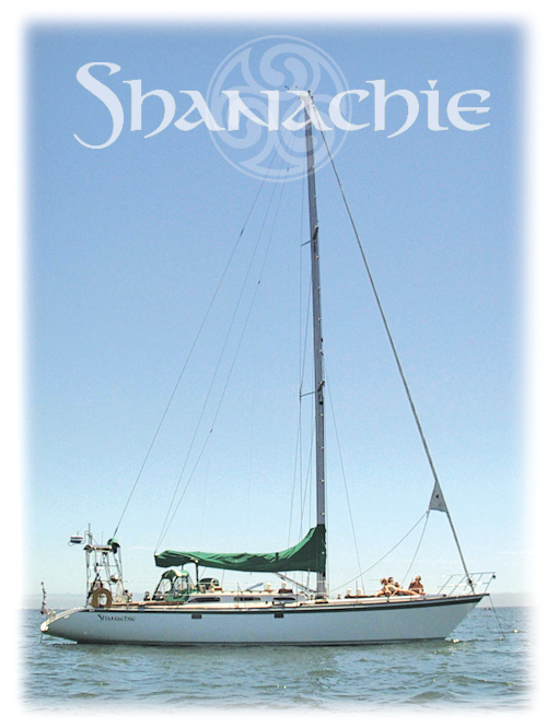 Shanachie anchored off the Santa Cruz wharf, with logo in the sky