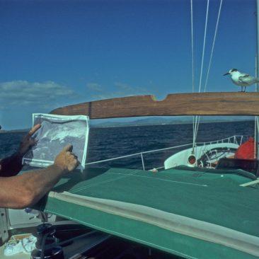 Joe shares early weatherfax info with a fellow seafarer