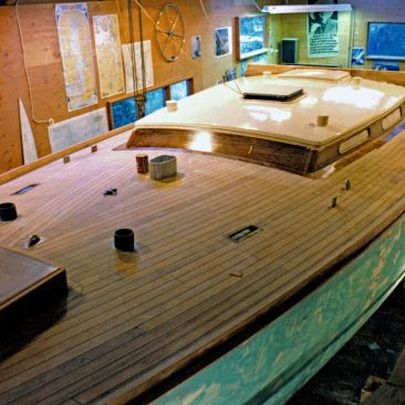 Completed teak deck with pre-painted hull