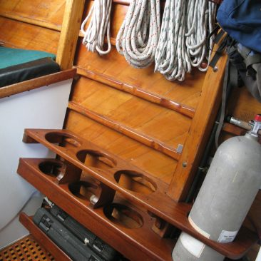 Built-in dive tank rack